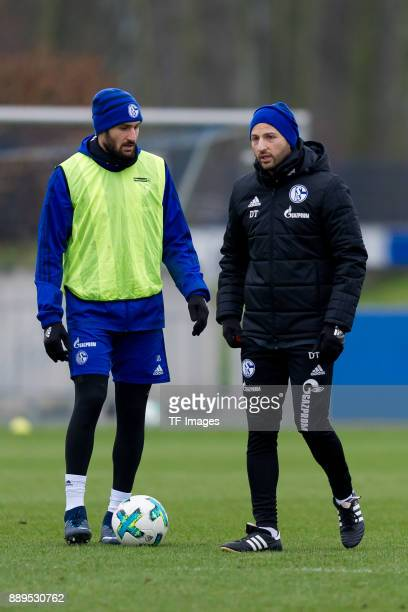 Daniel Caligiuri of Schalke and Head coach Domenico Tedesco of Schalke look on during a training session at the FC Schalke 04 Training center on...
