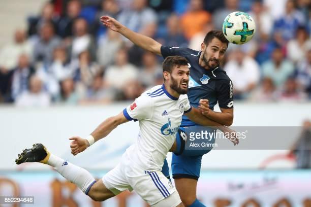 Daniel Caligiuri of Schalke fights for the ball with Lukas Rupp of Hoffenheim during the Bundesliga match between TSG 1899 Hoffenheim and FC Schalke...