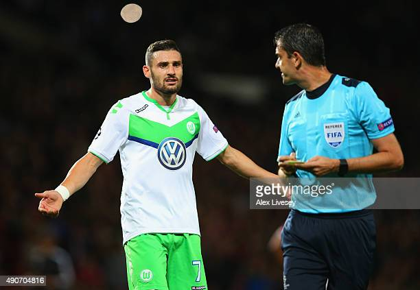 Daniel Caligiuri of VfL Wolfsburg appeals to referee Viktor Kassai during the UEFA Champions League Group B match between Manchester United FC and...