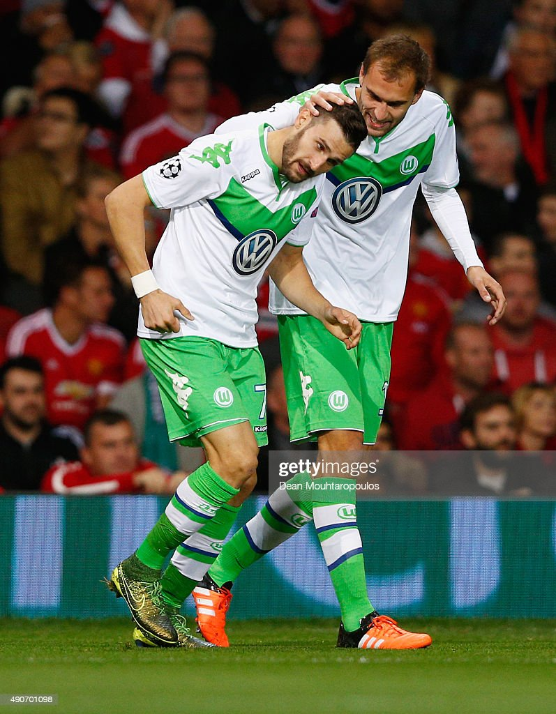 <a gi-track='captionPersonalityLinkClicked' href=/galleries/search?phrase=Daniel+Caligiuri&family=editorial&specificpeople=6495349 ng-click='$event.stopPropagation()'>Daniel Caligiuri</a> of VfL Wolfsburg (L) celebrates with <a gi-track='captionPersonalityLinkClicked' href=/galleries/search?phrase=Bas+Dost&family=editorial&specificpeople=7467816 ng-click='$event.stopPropagation()'>Bas Dost</a> as he scores their first goal during the UEFA Champions League Group B match between Manchester United FC and VfL Wolfsburg at Old Trafford on September 30, 2015 in Manchester, United Kingdom.