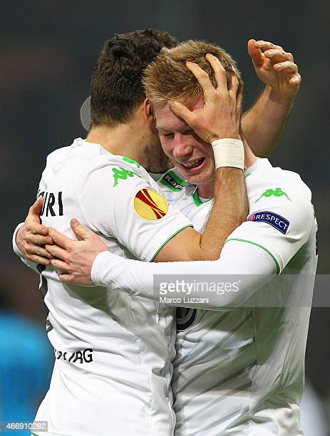 Daniel Caligiuri of VfL Wolfsburg celebrates with his teammate Kevin De Bruyne after scoring the opening goal during the UEFA Europa League Round of...