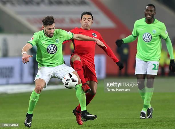 Daniel Caligiuri of Wolfsburg and Marco Fabian of Frankfurt compete the Bundesliga match between VfL Wolfsburg and Eintracht Frankfurt at Volkswagen...
