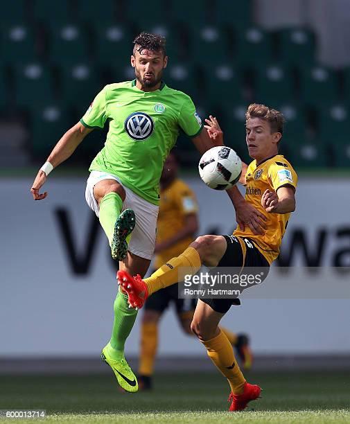 Daniel Caligiuri of Wolfsburg and Niklas Hauptmann of Dresden compete during the friendly match between VfL Wolfsburg and Dynamo Dresden at...