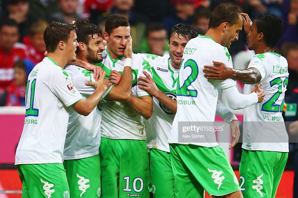 <a gi-track='captionPersonalityLinkClicked' href=/galleries/search?phrase=Daniel+Caligiuri&family=editorial&specificpeople=6495349 ng-click='$event.stopPropagation()'>Daniel Caligiuri</a> (2L) of Wolfsburg celebrates his team's first goal with team mates during the Bundesliga match between FC Bayern Muenchen and VfL Wolfsburg at Allianz Arena on September 22, 2015 in Munich, Germany.