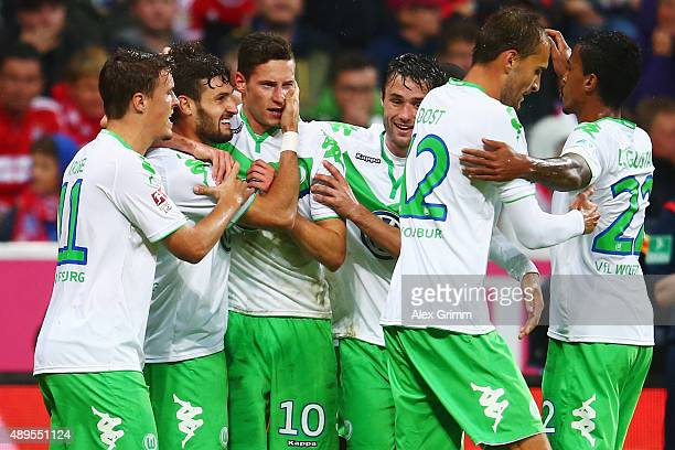Daniel Caligiuri of Wolfsburg celebrates his team's first goal with team mates during the Bundesliga match between FC Bayern Muenchen and VfL...