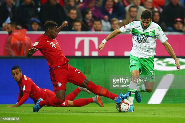Daniel Caligiuri of Wolfsburg is challenged by David Alaba and Thiago Alcantara of Muenchen during the Bundesliga match between FC Bayern Muenchen...