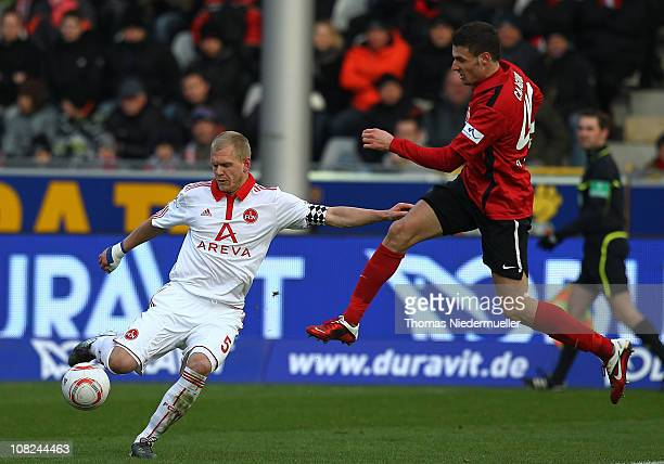 Daniel Caliguri of Freiburg fights for the ball with Andreas Wolf of Nuernberg during the Bundesliga match between SC Freiburg and 1FC Nuernberg at...