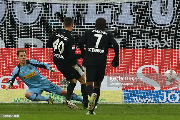 Daniel Caliguri of Freiburg scores his first goal by penalty against MarcAndre ter Stegen of Moenchengladbach during the Bundesliga match between VfL...