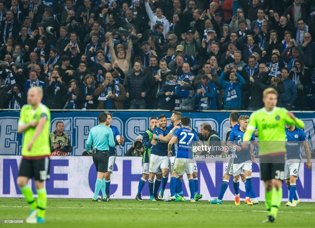 Daniel Caliguri (M) of Schalke and his team mates celebrate their third goal during the UEFA Europa League quarter final second leg match between FC Schalke 04 and Ajax Amsterdam at Veltins-Arena on April 20, 2017 in Gelsenkirchen, Germany.