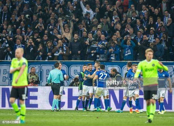 Daniel Caliguri of Schalke and his team mates celebrate their third goal during the UEFA Europa League quarter final second leg match between FC...