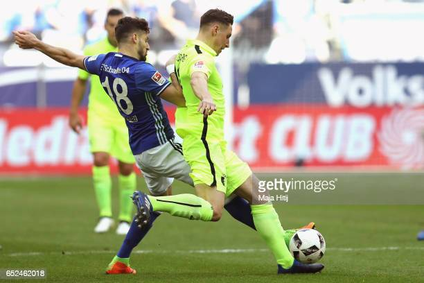 Daniel Caliguri of Schalke battles for the ball with Dominik Kohr of Augsburg during the Bundesliga match between FC Schalke 04 and FC Augsburg at...