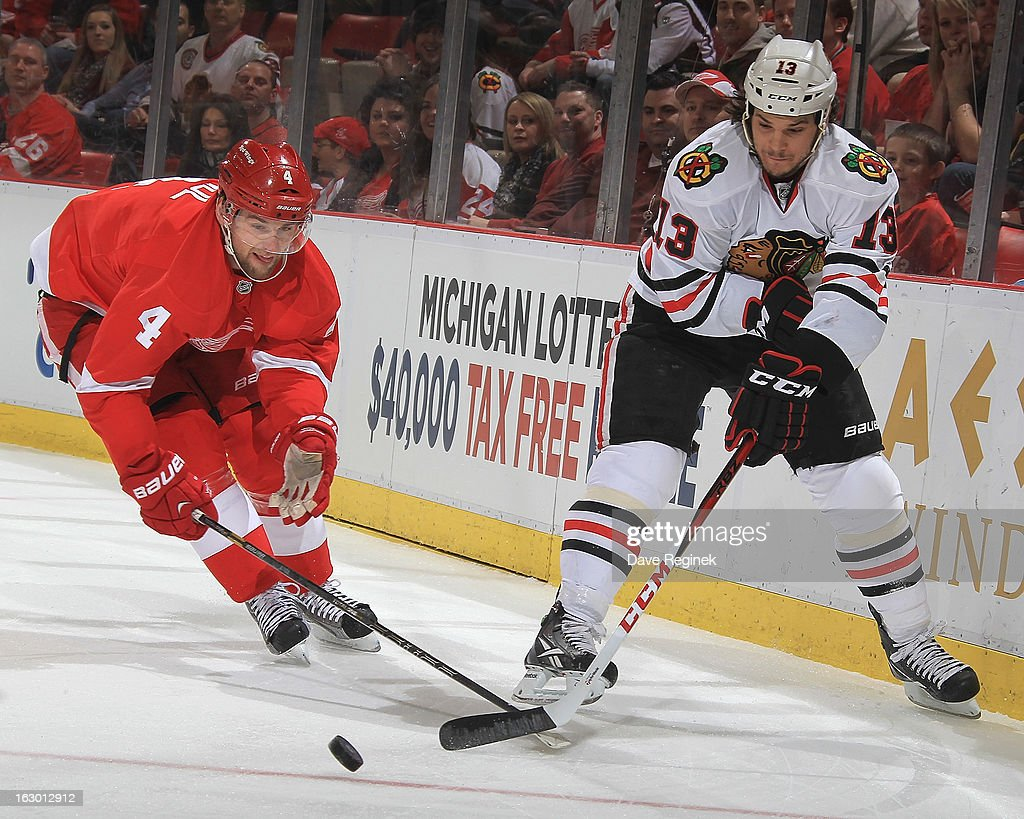 <a gi-track='captionPersonalityLinkClicked' href=/galleries/search?phrase=Daniel+Carcillo&family=editorial&specificpeople=2116181 ng-click='$event.stopPropagation()'>Daniel Carcillo</a> #13 of the Chicago Blackhawks battles for the puck with <a gi-track='captionPersonalityLinkClicked' href=/galleries/search?phrase=Jakub+Kindl&family=editorial&specificpeople=716743 ng-click='$event.stopPropagation()'>Jakub Kindl</a> #4 of the Detroit Red Wings during an NHL game at Joe Louis Arena on March 3, 2013 in Detroit, Michigan.