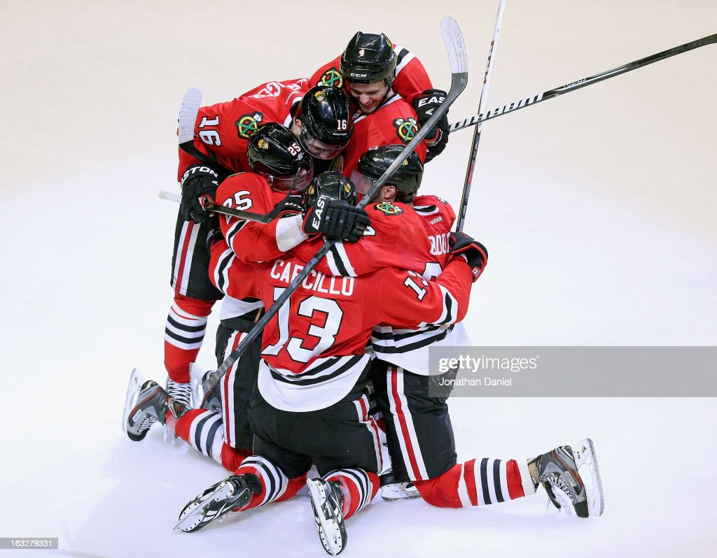 <a gi-track='captionPersonalityLinkClicked' href=/galleries/search?phrase=Daniel+Carcillo&family=editorial&specificpeople=2116181 ng-click='$event.stopPropagation()'>Daniel Carcillo</a> #13 of the Chicago Blackhawks celebrates his game-winning goal with teammates (L-R) <a gi-track='captionPersonalityLinkClicked' href=/galleries/search?phrase=Viktor+Stalberg&family=editorial&specificpeople=5802237 ng-click='$event.stopPropagation()'>Viktor Stalberg</a> #25, Marcus Kruger #16, <a gi-track='captionPersonalityLinkClicked' href=/galleries/search?phrase=Niklas+Hjalmarsson&family=editorial&specificpeople=2006442 ng-click='$event.stopPropagation()'>Niklas Hjalmarsson</a> #4 and Johnny Oduya #27 against the Colorado Avalanche at the United Center on March 6, 2013 in Chicago, Illinois. The Blackhawks defeated the Avalanche 3-2.