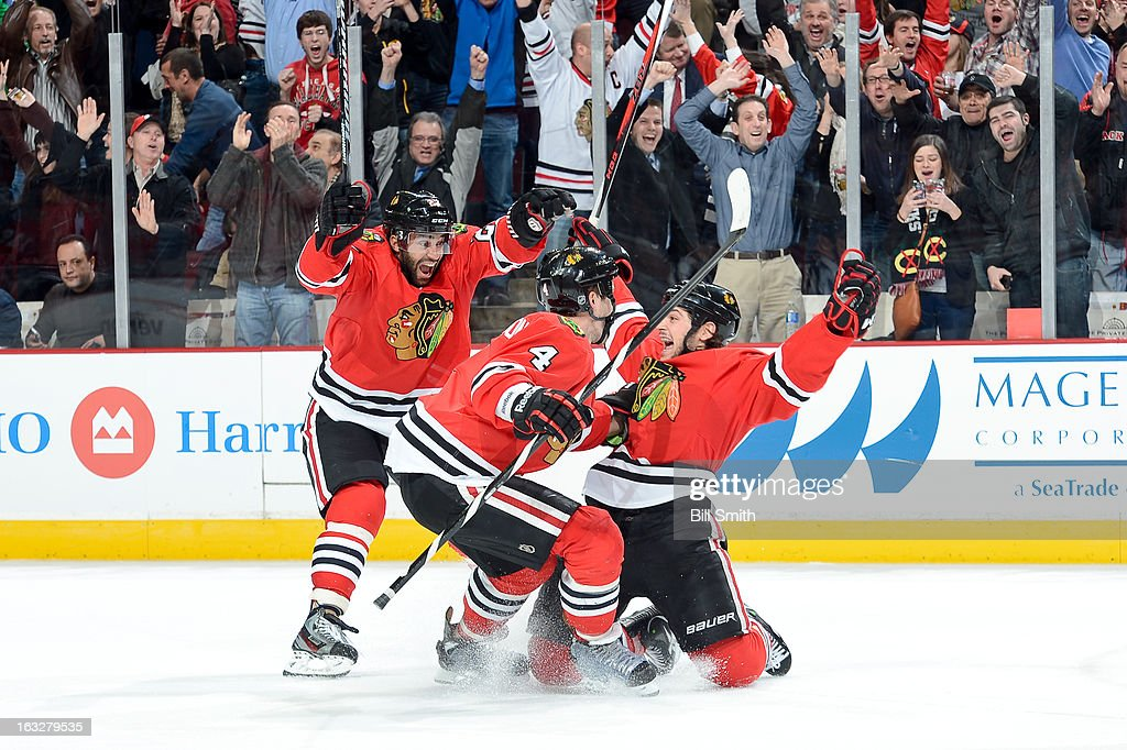 <a gi-track='captionPersonalityLinkClicked' href=/galleries/search?phrase=Daniel+Carcillo&family=editorial&specificpeople=2116181 ng-click='$event.stopPropagation()'>Daniel Carcillo</a> #13 of the Chicago Blackhawks celebrates with teammates <a gi-track='captionPersonalityLinkClicked' href=/galleries/search?phrase=Johnny+Oduya&family=editorial&specificpeople=3944055 ng-click='$event.stopPropagation()'>Johnny Oduya</a> #27 and <a gi-track='captionPersonalityLinkClicked' href=/galleries/search?phrase=Niklas+Hjalmarsson&family=editorial&specificpeople=2006442 ng-click='$event.stopPropagation()'>Niklas Hjalmarsson</a> #4 after scoring the game winning goal during the NHL game against the Colorado Avalanche on March 06, 2013 at the United Center in Chicago, Illinois.