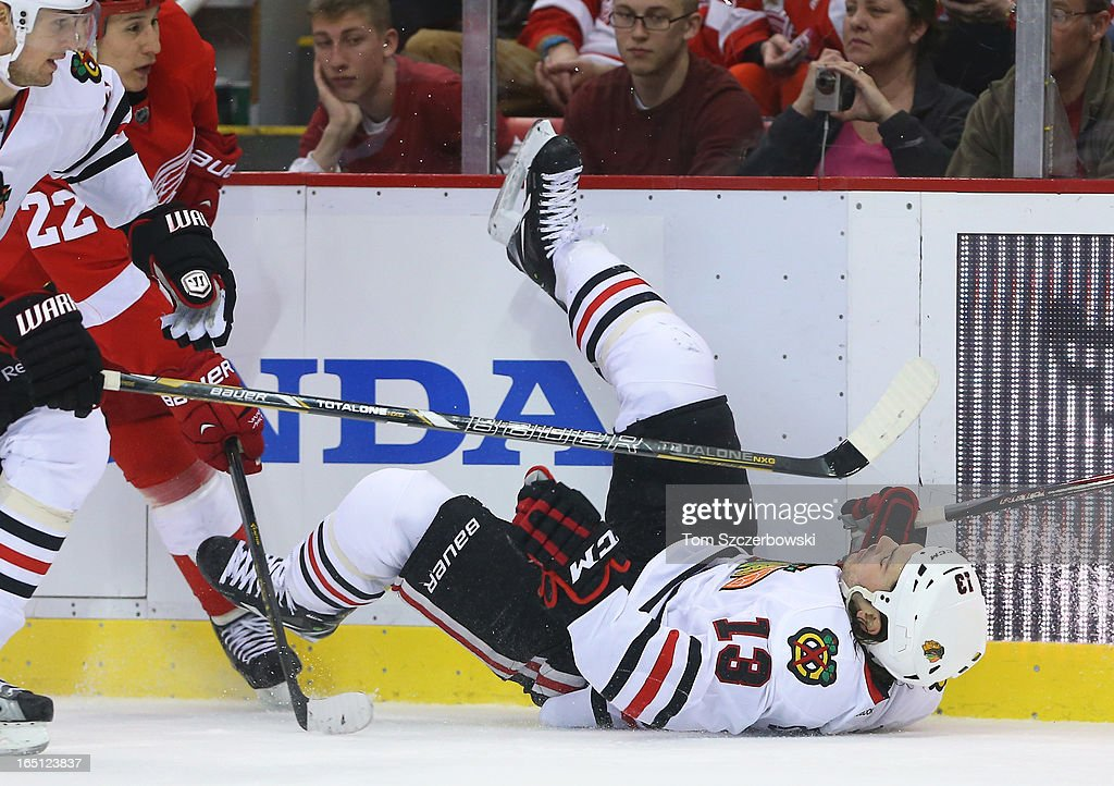 <a gi-track='captionPersonalityLinkClicked' href=/galleries/search?phrase=Daniel+Carcillo&family=editorial&specificpeople=2116181 ng-click='$event.stopPropagation()'>Daniel Carcillo</a> #13 of the Chicago Blackhawks falls to the ice during an NHL game against the Detroit Red Wings at Joe Louis Arena on March 31, 2013 in Detroit, Michigan.