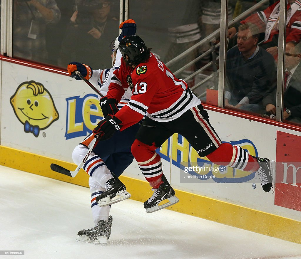 <a gi-track='captionPersonalityLinkClicked' href=/galleries/search?phrase=Daniel+Carcillo&family=editorial&specificpeople=2116181 ng-click='$event.stopPropagation()'>Daniel Carcillo</a> #13 of the Chicago Blackhawks hits Chris VandeVelde #54 of the Edmonton Oilers at the United Center on February 25, 2013 in Chicago, Illinois.