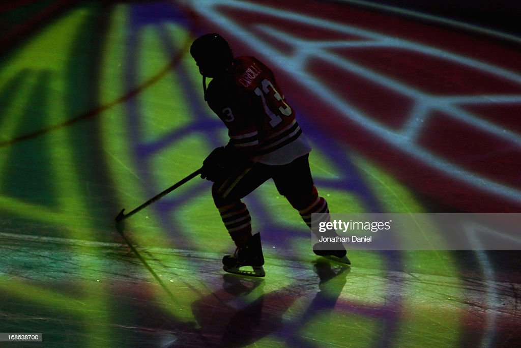 Daniel Carcillo #13 of the Chicago Blackhawks skates onto the ice during player introductions before taking on the Minnesota Wild in Game Five of the Western Conference Quarterfinals during the 2013 NHL Stanley Cup Playoffs at the United Center on May 9, 2013 in Chicago, Illinois. The Blackhawks defeated the Wild 5-1 to win the series.