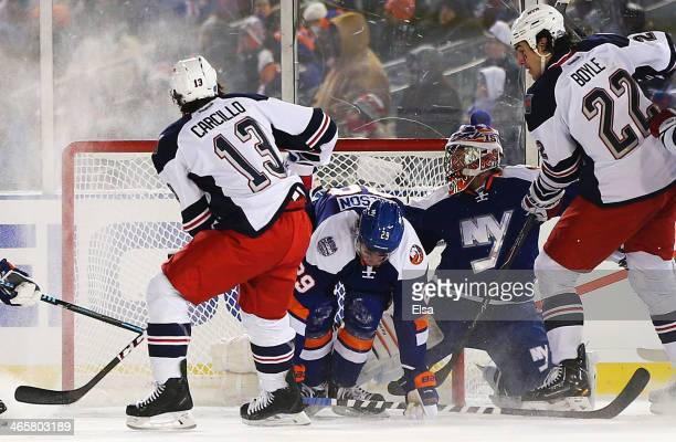 Daniel Carcillo of the New York Rangers scores a third period goal against Evgeni Nabokov of the New York Islanders during the 2014 Coors Light NHL...