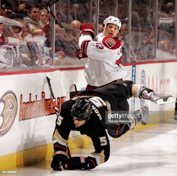 Daniel Carcillo of the Phoenix Coyotes collides into the boards against Steve Montador of the Anaheim Ducks during the game on January 4 2009 at...