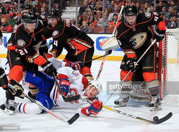Daniel Carr of the Montreal Canadiens reaches for the puck in front of Chris Wagner Sami Vatanen of the Anaheim Ducks at Honda Center in Anaheim...