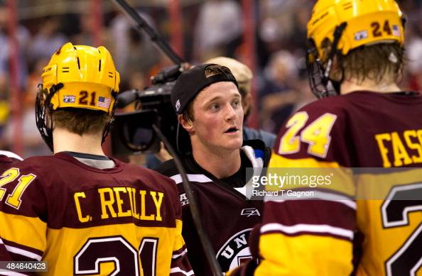 Daniel Carr of the Union College Dutchmen shakes hands with the Minnesota Golden Gophers after the NCAA Division I Men's Ice Hockey Frozen Four...
