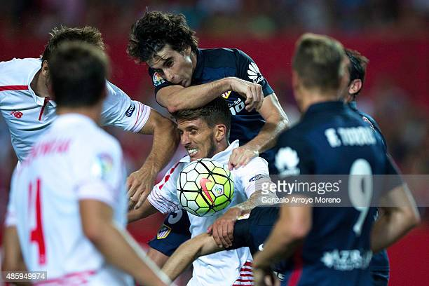 Daniel Carrico of Sevilla FC competes for the ball with Tiago Mendes of Atletico de Madrid during the La Liga match between Sevilla FC and Club...