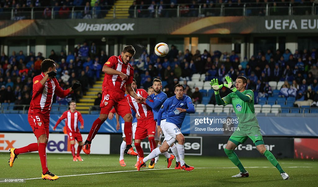 Daniel Carrico of Sevilla heads the ball during the UEFA Europa League Round of 32 second leg match between Molde and Sevilla at Aker Stadion on...