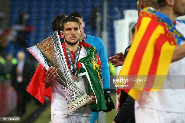 Daniel Carrico of Sevilla holds the trophy after the UEFA Europa League Final match between Liverpool and Sevilla at St JakobPark on May 18 2016 in...