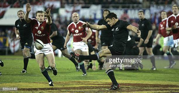 Daniel Carter clears as Dwayne Peel tries a block during the All Blacks V British Lions first rugby test at Jade stadium New Zealand won...
