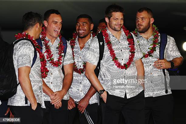 Daniel Carter Israel Dagg Charles Piutau and Richie McCaw of the New Zealand All Blacks are welcomed at Faleolo Airport on July 6 2015 in Apia Samoa