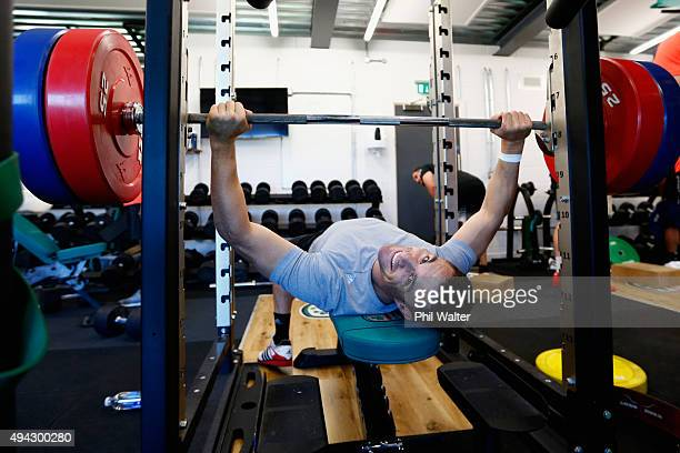 Daniel Carter of the All Blacks manages to look up from the bench press during a New Zealand All Blacks training session at London Irish on October...