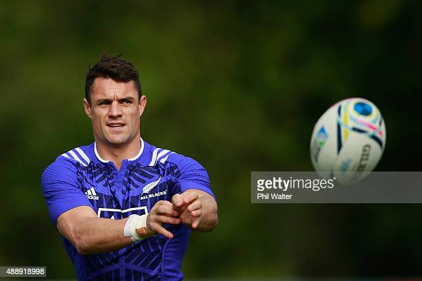 Daniel Carter of the All Blacks passes during a New Zealand All Blacks training session at Lensbury on September 18 2015 in London United Kingdom
