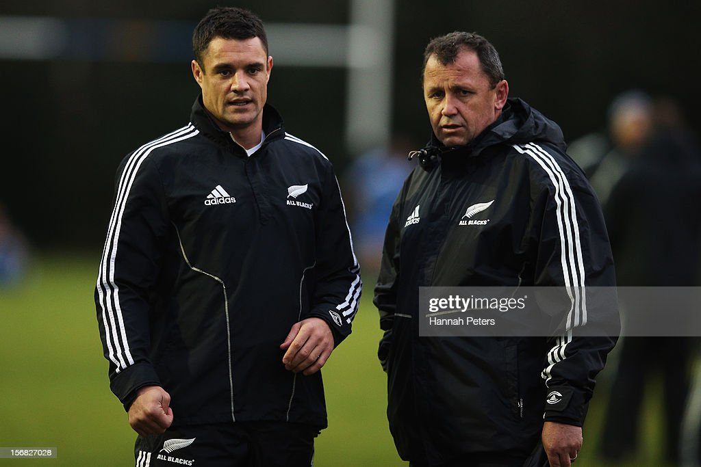 Daniel Carter of the All Blacks speaks to assistant coach Ian Foster during a training session at the University of Glamorgan training fields on November 22, 2012 in Cardiff, Wales.