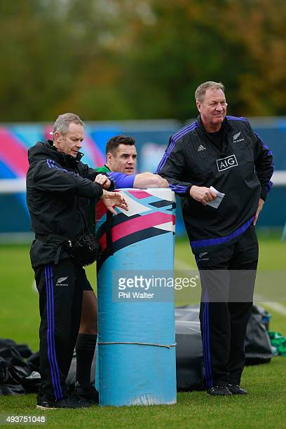 Daniel Carter of the All Blacks watches training with Dr Tony Page and Mick Byrne during a New Zealand All Blacks training session at London Irish on...