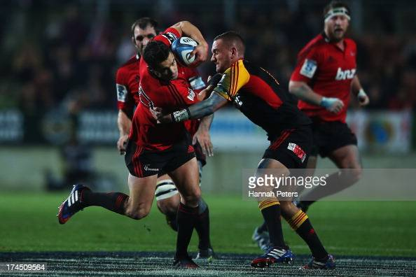 Daniel Carter of the Crusaders tries to get past Aaron Cruden of the Chiefs during the Super Rugby semi final match between the Chiefs and the...