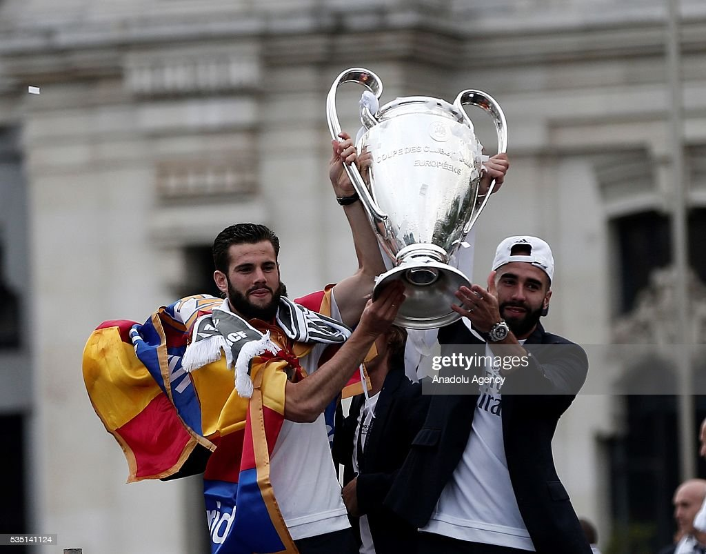 Daniel Carvahal (R) and Nacho (L) of Real Madrid CF hold the trophy in celebration during their team celebration at Cibeles square after winning the UEFA Champions League Final match against Club Atletico de Madrid on May 29, 2016 in Madrid, Spain.