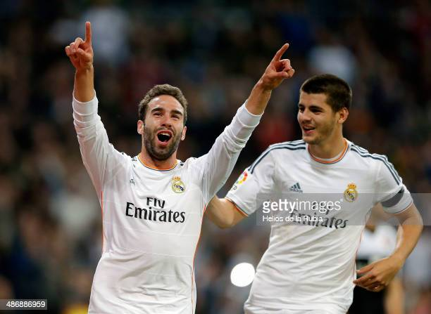 Daniel Carvajal and Alvaro Morata of Real Madrid celebrate after scoring during the La Liga match between Real Madrid and CA Osasuna at Estadio...
