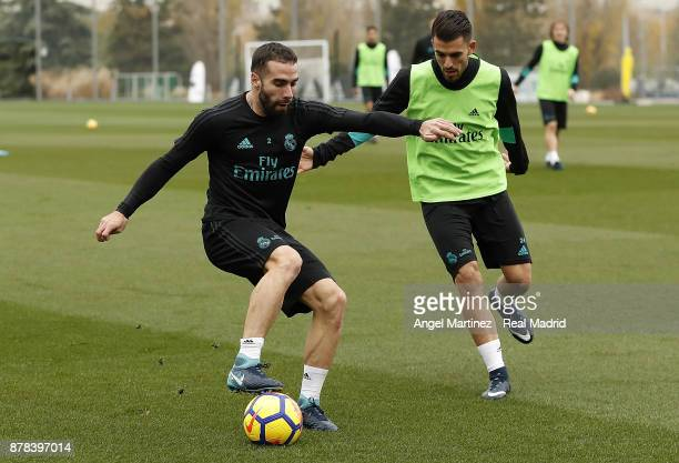 Daniel Carvajal and Dani Ceballos of Real Madrid in action during a training session at Valdebebas training ground on November 24 2017 in Madrid Spain