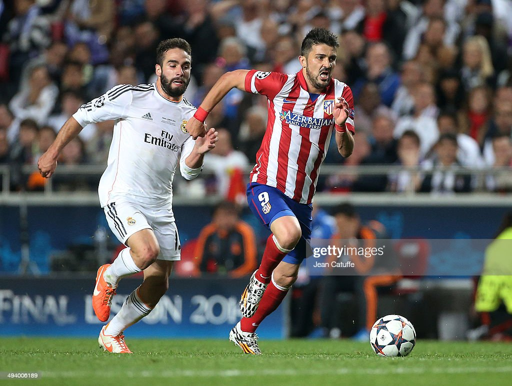 Daniel Carvajal and David Villa of Atletico Madrid in action during the UEFA Champions League final between Real Madrid and Atletico de Madrid at Estadio da Luz stadium on May 24, 2014 in Lisbon, Portugal.