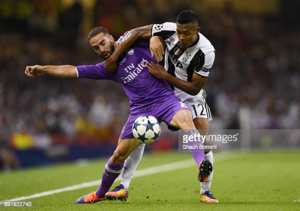 Daniel Carvajal of Real Madrid and Alex Sandro of Juventus battle for possession during the UEFA Champions League Final between Juventus and Real...