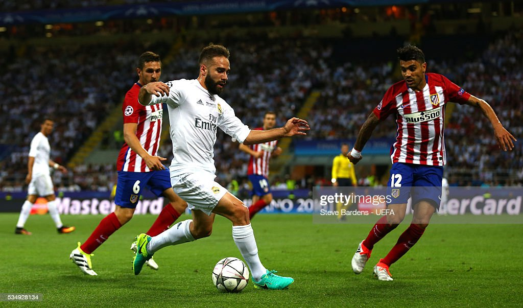 Daniel Carvajal of Real Madrid and <a gi-track='captionPersonalityLinkClicked' href=/galleries/search?phrase=Augusto+Fernandez&family=editorial&specificpeople=684736 ng-click='$event.stopPropagation()'>Augusto Fernandez</a> of Atletico Madrid compete for the ball during the UEFA Champions League Final between Real Madrid and Club Atletico de Madrid at Stadio Giuseppe Meazza on May 28, 2016 in Milan, Italy.