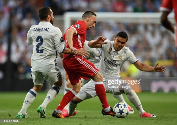 Daniel Carvajal of Real Madrid and Casemiro of Real Madrid put pressure on Franck Ribery of Bayern Muenchen during the UEFA Champions League Quarter...
