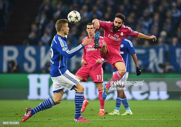Daniel Carvajal of Real Madrid and Felix Platte of Schalke challnge for the ball during the UEFA Champions League Round of 16 match between FC...