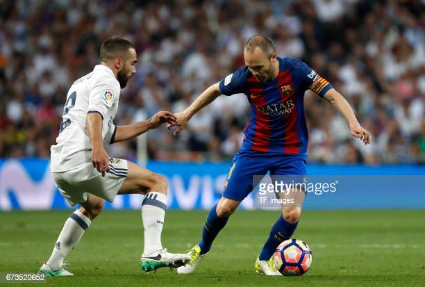 Daniel Carvajal of Real Madrid and Inesta of Real Madrid battle for the ball during the La Liga match between Real Madrid CF and FC Barcelona at the...