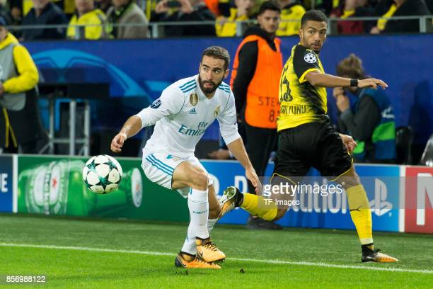 Daniel Carvajal of Real Madrid and Jeremy Toljan of Dortmund battle for the ball during the UEFA Champions League group H match between Borussia...