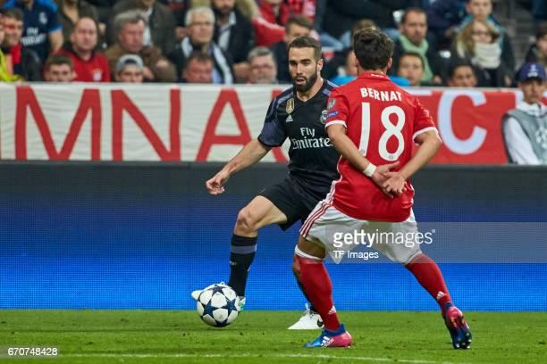 Daniel Carvajal of Real Madrid and Juan Bernat of Munich battle for the ball during the UEFA Champions League Quarter Final first leg match between...