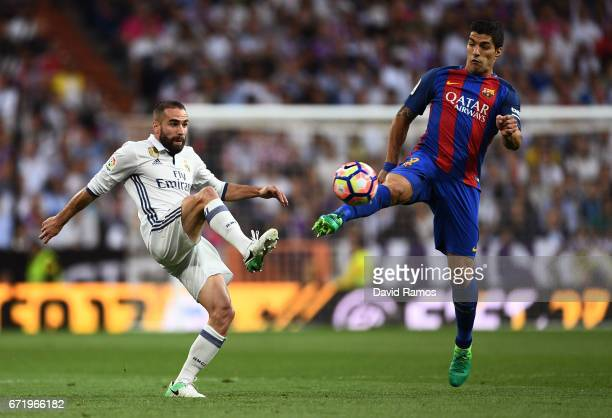 Daniel Carvajal of Real Madrid and Luis Suarez of Barcelona battle for the ball during the La Liga match between Real Madrid CF and FC Barcelona at...