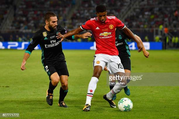 Daniel Carvajal of Real Madrid and Marcus Rashford of Manchester United battle for possession during the UEFA Super Cup final between Real Madrid and...