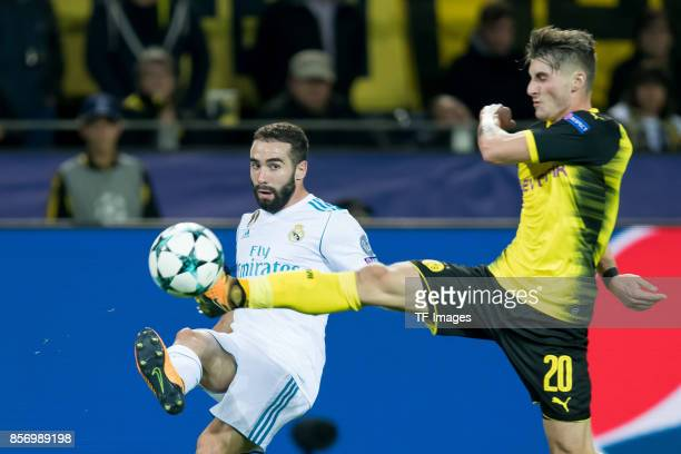 Daniel Carvajal of Real Madrid and Maximilian Philipp of Dortmund battle for the ball during the UEFA Champions League group H match between Borussia...