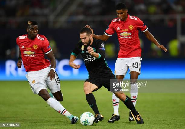 Daniel Carvajal of Real Madrid attempts to get away from Paul Pogba of Manchester United and Marcus Rashford of Manchester United during the UEFA...